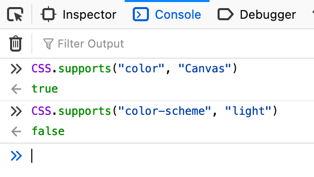 Screenshot of the console in Firefox denoting how CSS system colors like `Canvas` are supported but the `color-scheme` property is not.